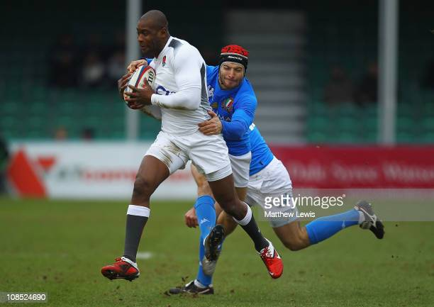 Ugo Monye of England break through the tackle of Michele Sepe of Italy during the International match between England Saxons and Italy A at Sixways...