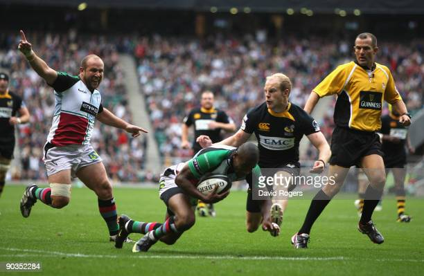 Ugo Monye of Harlequins dives over to score the first try during the Guinness Premiership match between London Wasps and Harlequins at Twickenham...
