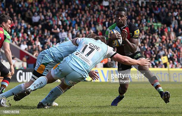 Ugo Monye of Harlequins is tackled by Alex Waller during the Aviva Premiership match between Harlequins and Northampton Saints at Twickenham Stoop on...