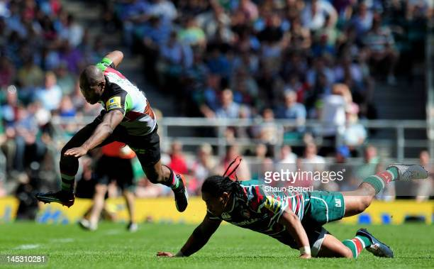 Ugo Monye of Harlequins is tap tackled by Alesana Tuilagi of Leicester during the Aviva Premiership final between Harlequins and Leicester Tigers at...