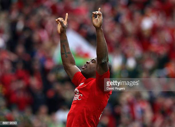 Ugo Monye of the Lions celebrates after scoring a breakaway try during the Third Test match between South Africa and the British and Irish Lions at...
