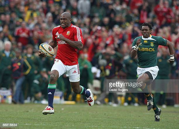 Ugo Monye of the Lions races away to score a breakaway try during the Third Test match between South African and the British and Irish Lions at Ellis...