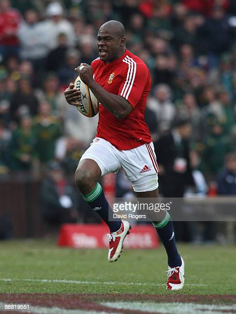 Ugo Monye of the Lions races clear to score a breakaway try during the Third Test match between South Africa and the British and Irish Lions at Ellis...
