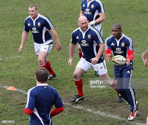 Ugo Monye passes the ball to new replacement props John Hayes and Tim Payne during the British and Irish Lions training session held at Bishops...