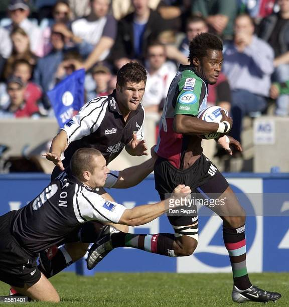 Ugo Moyne of Quins is tackled by the Newcastle defence during the Zurich Premiership match between NEC Harlequins and Newcastle Falcons at the Stoop...
