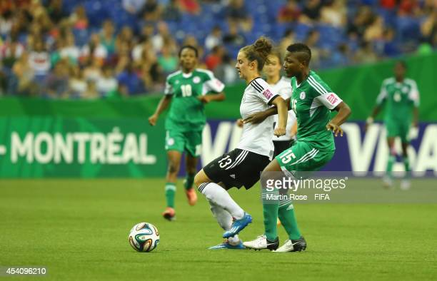 Ugo Njoku of Nigeria and Sara Daebritz of Germany battle for the ball during the FIFA U20 Women's World Cup 2014 final match between Nigeria and...