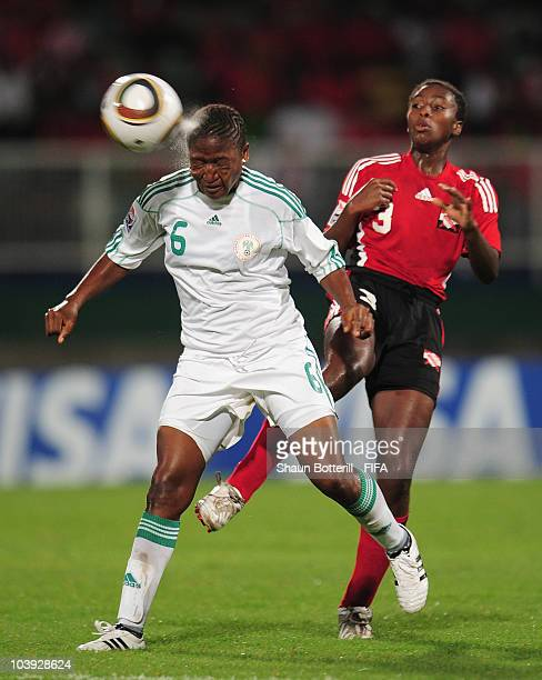 Ugo Njoku of Nigeria heads the ball as Diarra Simmons of Trinidad Tobago looks on during the FIFA U17 Women's World Cup Group A match between...