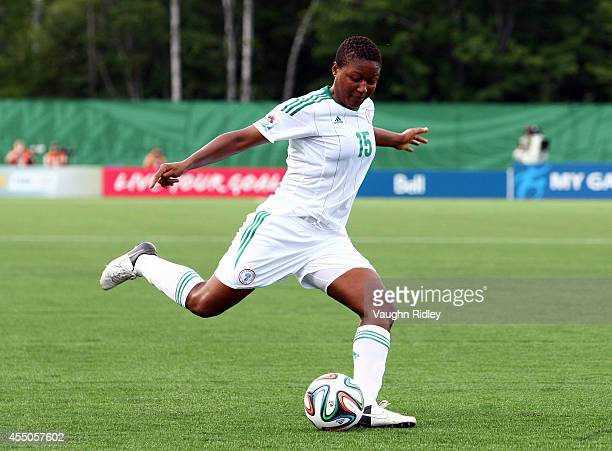 Ugo Njoku of Nigeria in action during the FIFA U20 Women's World Cup Canada 2014 Semi Final match between Korea DPR and Nigeria at Moncton Stadium on...