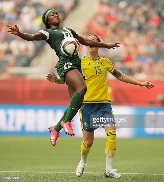 Ugo Njoku of Nigeria is challenged by Therese Sjogran of Sweden during the FIFA Women's World Cup Canada 2015 Group D match between Sweden and...