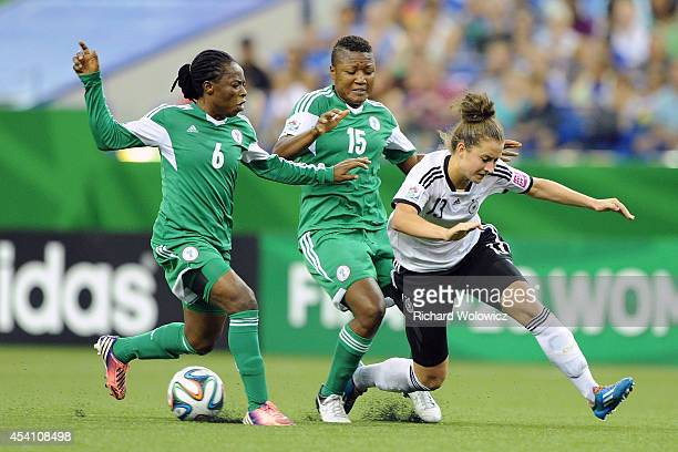Ugo Njoku of Nigeria strips the ball from Sara Daebritz of Germany during the FIFA Women's U20 Final at Olympic Stadium on August 24 2014 in Montreal...