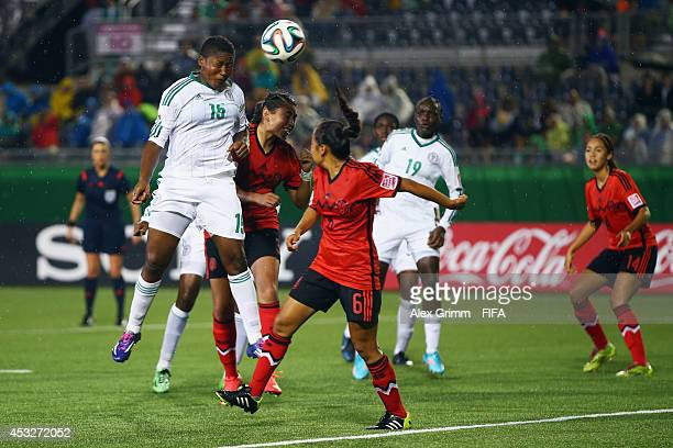 Ugo Njoku of Nigeria tries to score with a header during the FIFA U20 Women's World Cup Canada 2014 group C match between Mexico and Nigeria at...