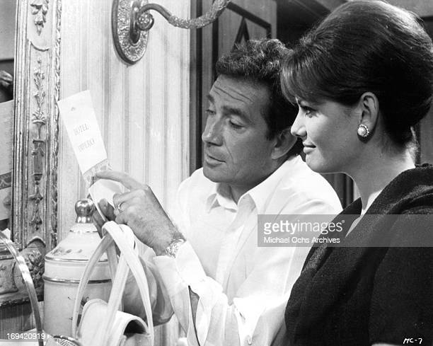Ugo Tognazzi showing hotel stationary to Michele Girardon in a scene from the film 'The Magnificent Cuckold' 1964