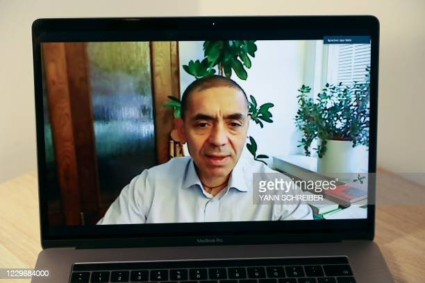 Ugur Sahin, scientist, CEO and co-founder of German biotechnology company BioNTech appears on a computer screen in Frankfurt am Main during an...