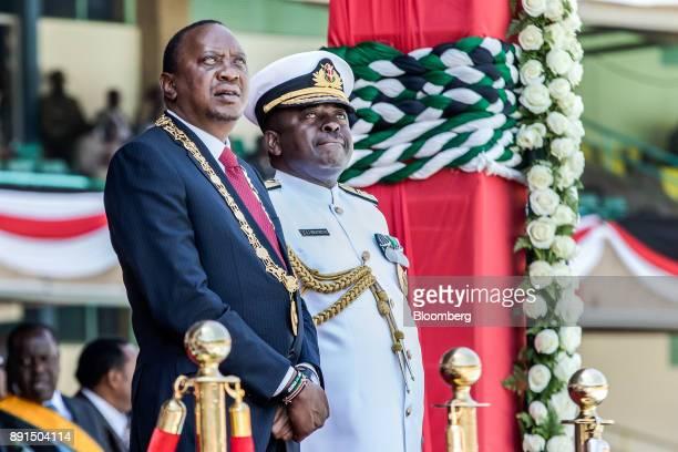 Uhuru Kenyatta Kenya's president left and Samson Mwathethe Kenya's chief of defence forces attend the independence celebrations on Jamhuri Day at...