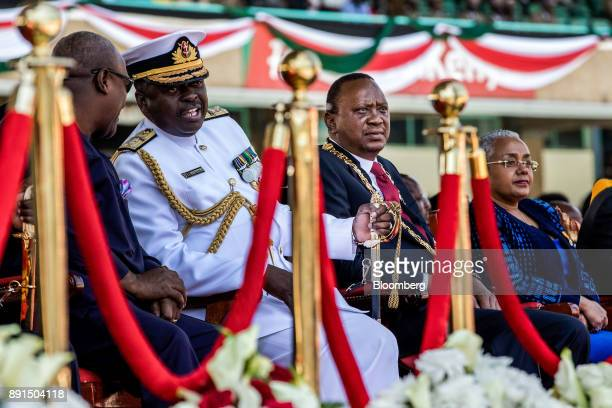 Uhuru Kenyatta Kenya's president second right his wife Margaret right and Samson Mwathethe Kenya's chief of defence forces attend the independence...