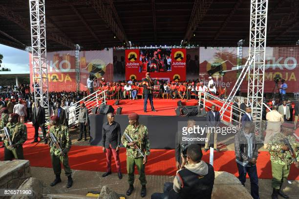 Uhuru Kenyatta Kenya's president speaks from a stage surrounded by armed soldiers during a presidential election rally for the Jubilee Party in...