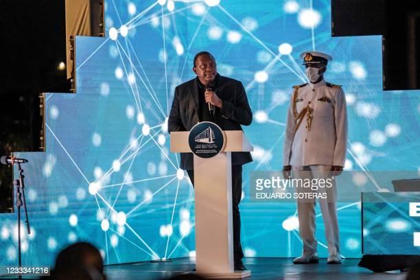Uhuru Kenyatta, President of Kenya, addresses the public during the ceremony for the signing of Ethiopias telecom licensing agreement, in Addis...