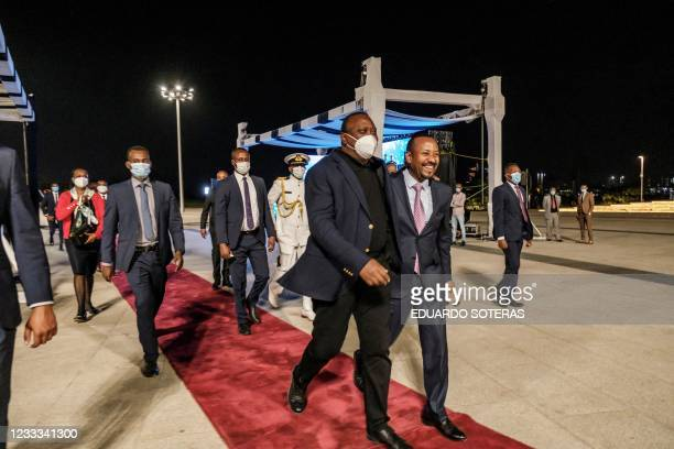 Uhuru Kenyatta , President of Kenya, and Abiy Ahmed, Prime Minister of Ethiopia, walk out after the ceremony for the signing of Ethiopias telecom...