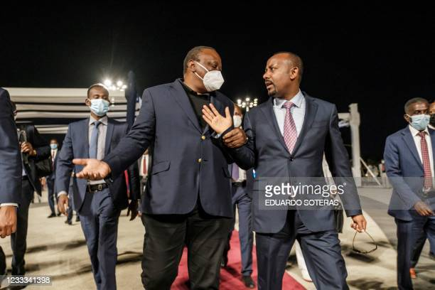 Uhuru Kenyatta , President of Kenya, and Abiy Ahmed, Prime Minister of Ethiopia, talk after the ceremony for the signing of Ethiopias telecom...