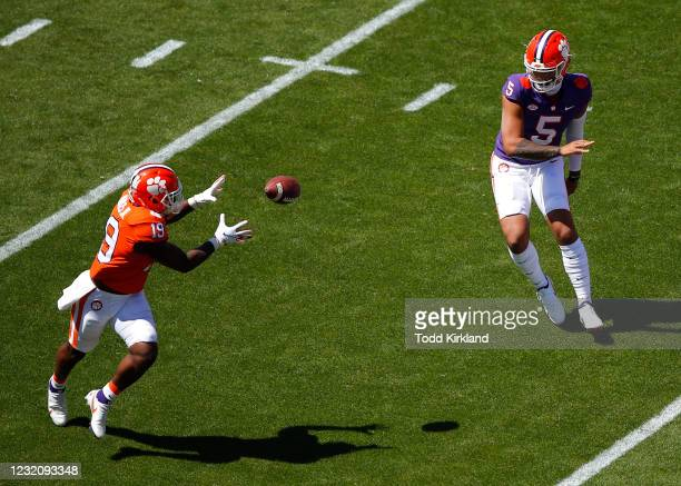 Uiagalelei of the Clemson Tigers laterals to Michel Dukes during the second half of the Clemson Orange and White Spring Game at Memorial Stadium on...