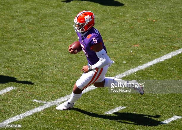 Uiagalelei of the Clemson Tigers scrambles during the second half of the Clemson Orange and White Spring Game at Memorial Stadium on April 3, 2021 in...