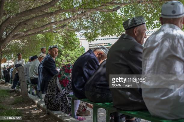 TOWN KASHGAR XINJIANG CHINA Uighur Chinese local Muslims attends Friday afternoon prayers near the Id Kah Mosque under police surveillance in the...