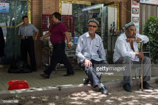 Uighur Chinese local Muslims attends Friday afternoon prayers near the Id Kah Mosque under police surveillance in the Kashgar old Town, northwestern...