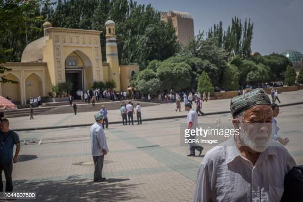 Uighur Chinese local Muslims leave Id Kah Mosque after Friday afternoon prayers in the Kashgar old Town, northwestern Xinjiang Uyghur Autonomous...