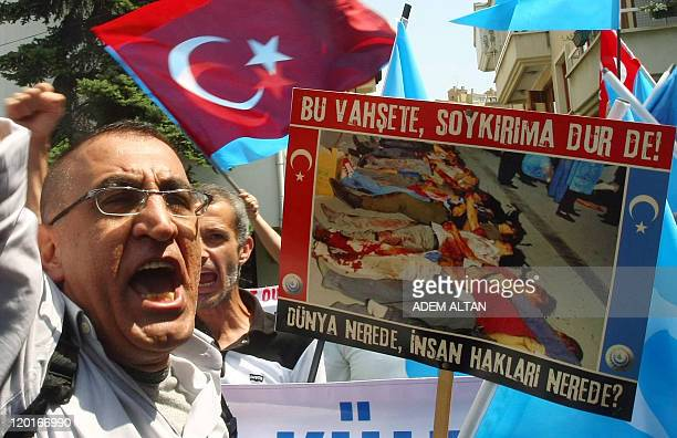 Uighur living in Turkey holds a beanner reading ''Stop the violence, stop the genocide!, Where is the world, where's human rights?'' as he takes part...