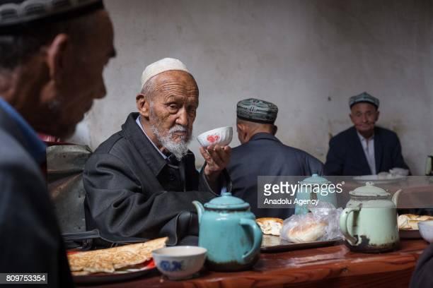Uighur man drinks tea at a local tea shop in Kashgar City northwest China's Xinjiang Uyghur Autonomous Region in China on July 06 2017
