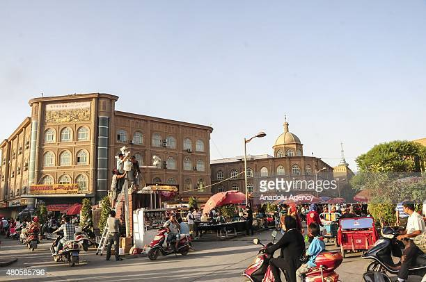 Uighur people are seen in northwestern China's Xinjiang Uighur Autonomous Region's Kashgar city on July 07 2015