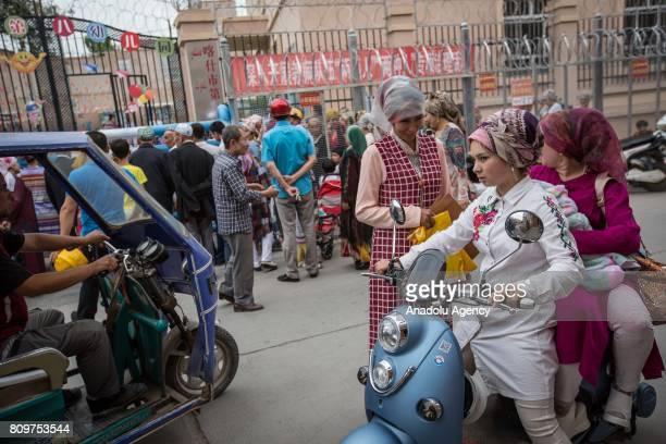 Uighur people pick up their kids from school in Kashgar City northwest China's Xinjiang Uyghur Autonomous Region in China on July 06 2017