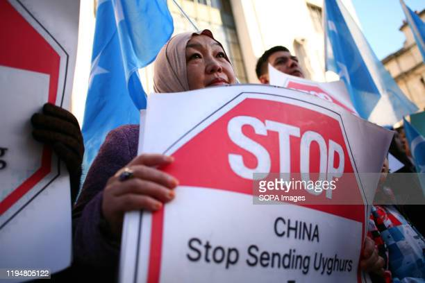 Uighur right activist holds a placard during the protest Activists rally in solidarity with the prodemocracy movement in Hong Kong and in protest at...