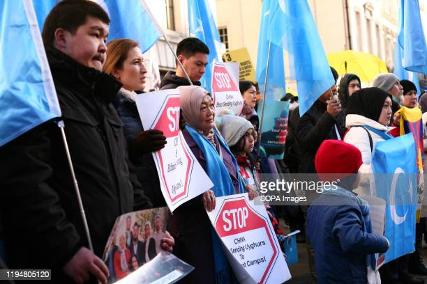 Uighur right activists hold placards during the protest Activists rally in solidarity with the prodemocracy movement in Hong Kong and in protest at...