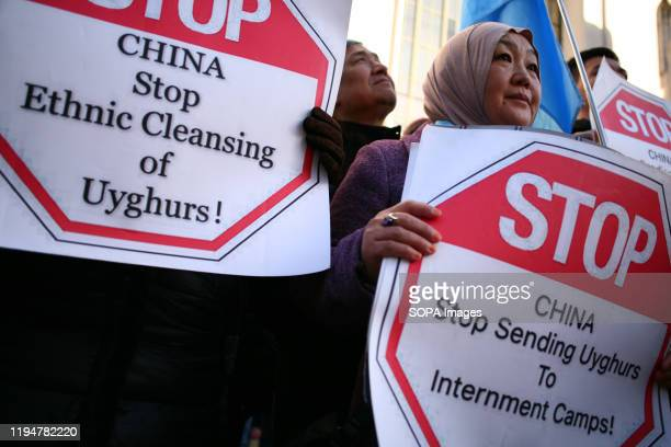 Uighur rights activists hold placards during the protest Activists rally in solidarity with the prodemocracy movement in Hong Kong and in protest at...
