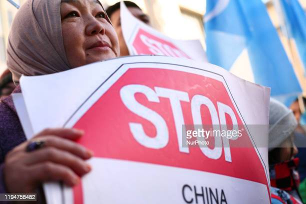 Uighur rights activists rally in solidarity with the prodemocracy movement in Hong Kong and in protest at China's treatment of its Tibetan and Uighur...