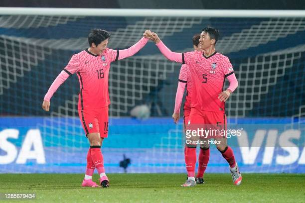 Uijo Hwang of South Korea celebrates with teammate Wooyoung Jung after scoring his team's first goal during the international friendly match between...