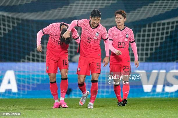 Uijo Hwang of South Korea celebrates with teammates after scoring his team's first goal during the international friendly match between Mexico and...