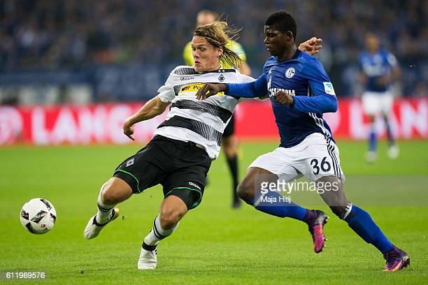 Uilson de Souza Paula Junior of Schalke is challenged by Jannik Vestergaard of Moenchengladbach during the Bundesliga match between FC Schalke 04 and...