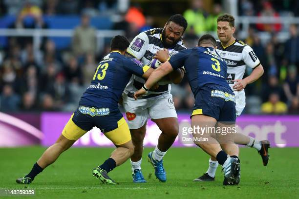 Uini Atonio of La Rochelle is tackled by George Moala and Rabah Slimani of ASM Clermont Auvergne during the Challenge Cup Final match between La...