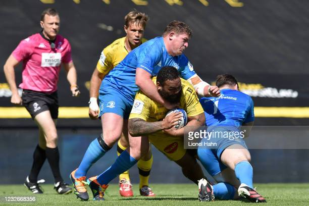 Uini Atonio of La Rochelle is tackled by Tadhg Furlong and Can Healy of Leinster during the Heineken Champions Cup Semi-Final match between La...