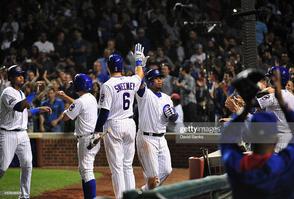 L uis Valbuena #24 of the Chicago Cubs is greeted by Ryan Sweeney #6 after hitting a two-run homer against the Colorado Rockies during the eighth inning on July 30, 2014 at Wrigley Field in Chicago, Illinois.