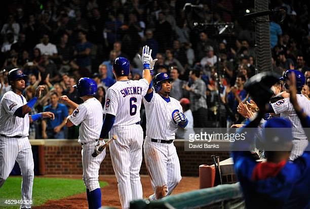 L uis Valbuena of the Chicago Cubs is greeted by Ryan Sweeney after hitting a tworun homer against the Colorado Rockies during the eighth inning on...