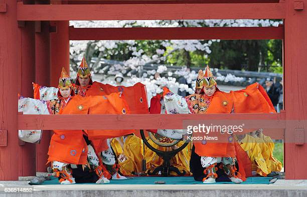 Uji Japan A bugaku dance and music performance takes place at a ceremony at World Heritage site Byodoin temple's Phoenix Hall in Uji Kyoto Prefecture...