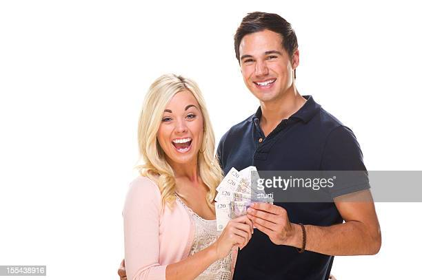 uk couple holding cash - british pound sterling note stock pictures, royalty-free photos & images