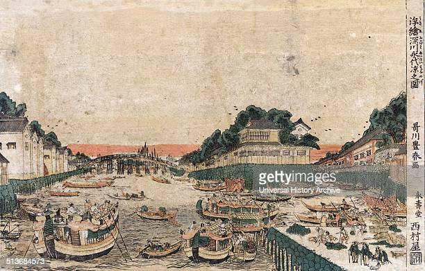 Ukie Fukagawa eitai suzumi no zu Perspective view of enjoying the evening cool in Fukagawa By Toyoharu Utagawa 17351814 Print shows many boats large...