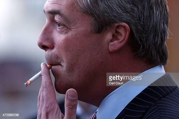 Ukip leader Nigel Farage smokes a cigarette before addressing supporters in his final rally before the general election on May 6 2015 in Ramsgate...