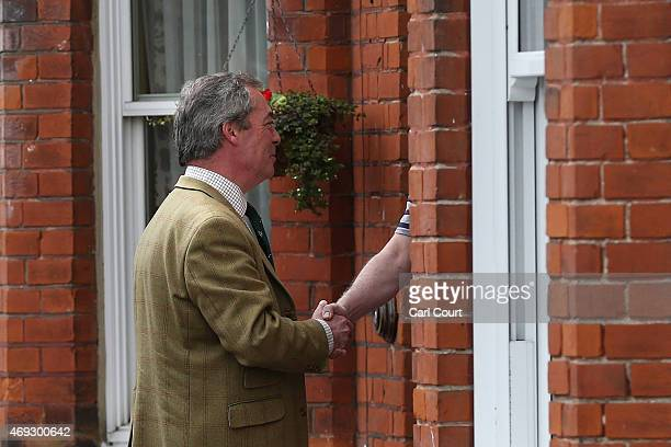 Ukip leader Nigel Farage speaks with a resident as he canvasses in the Thanet South constituency on April 11 2015 in Broadstairs England The party...