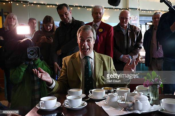 Ukip leader Nigel Farage speaks with supporters as he prepares to canvass in the Thanet South constituency on April 11 2015 in Broadstairs England...