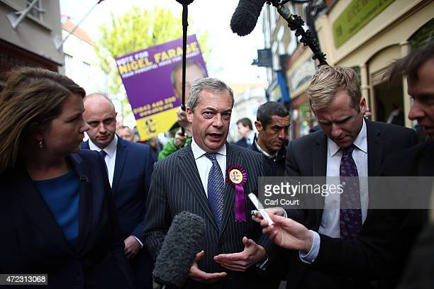 Ukip leader Nigel Farage talks with journalists as he canvasses on May 6 2015 in Ramsgate England Mr Farage is canvassing in South Thanet on the...